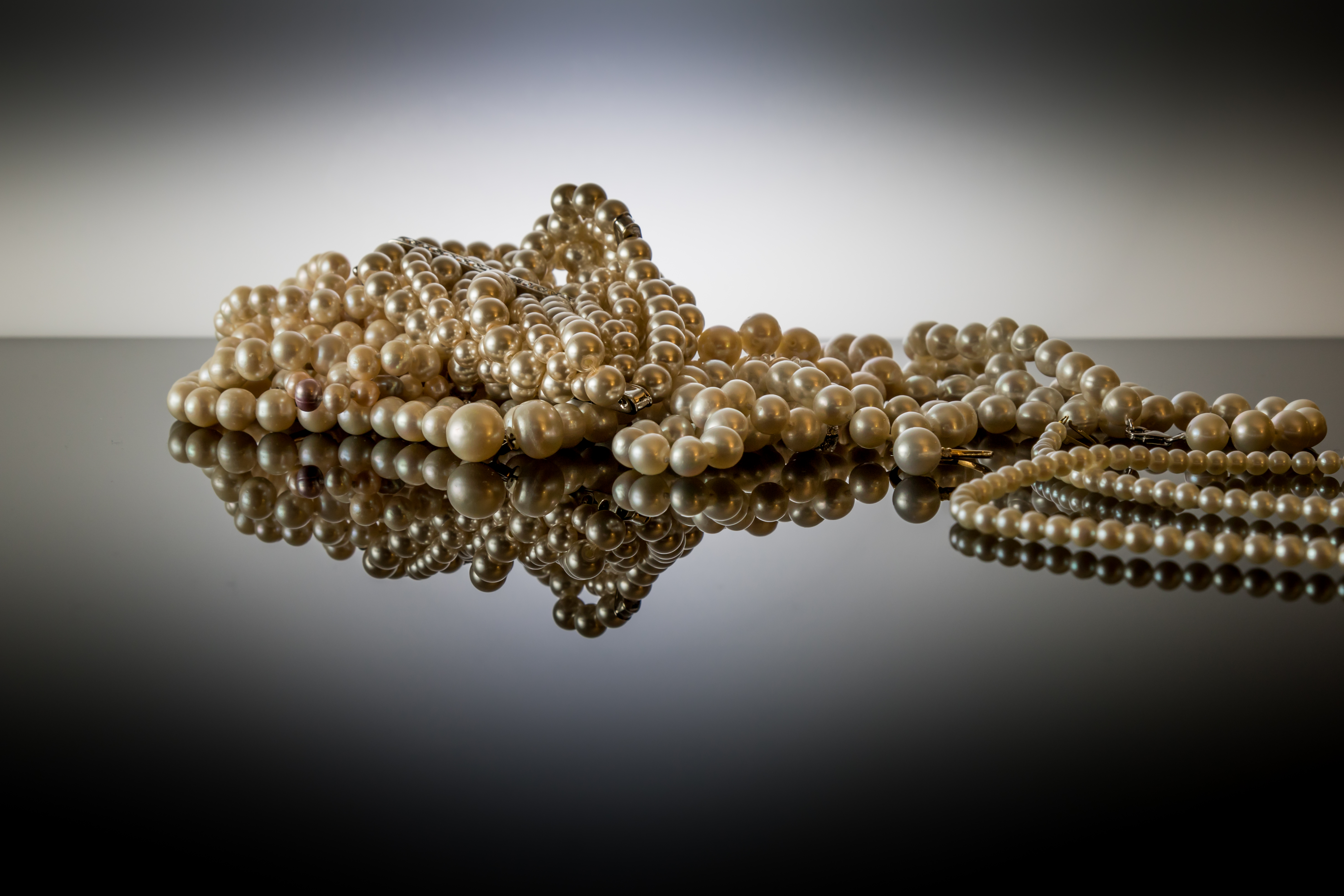 PEARLS ON A REFLECTIVE SURFACE.