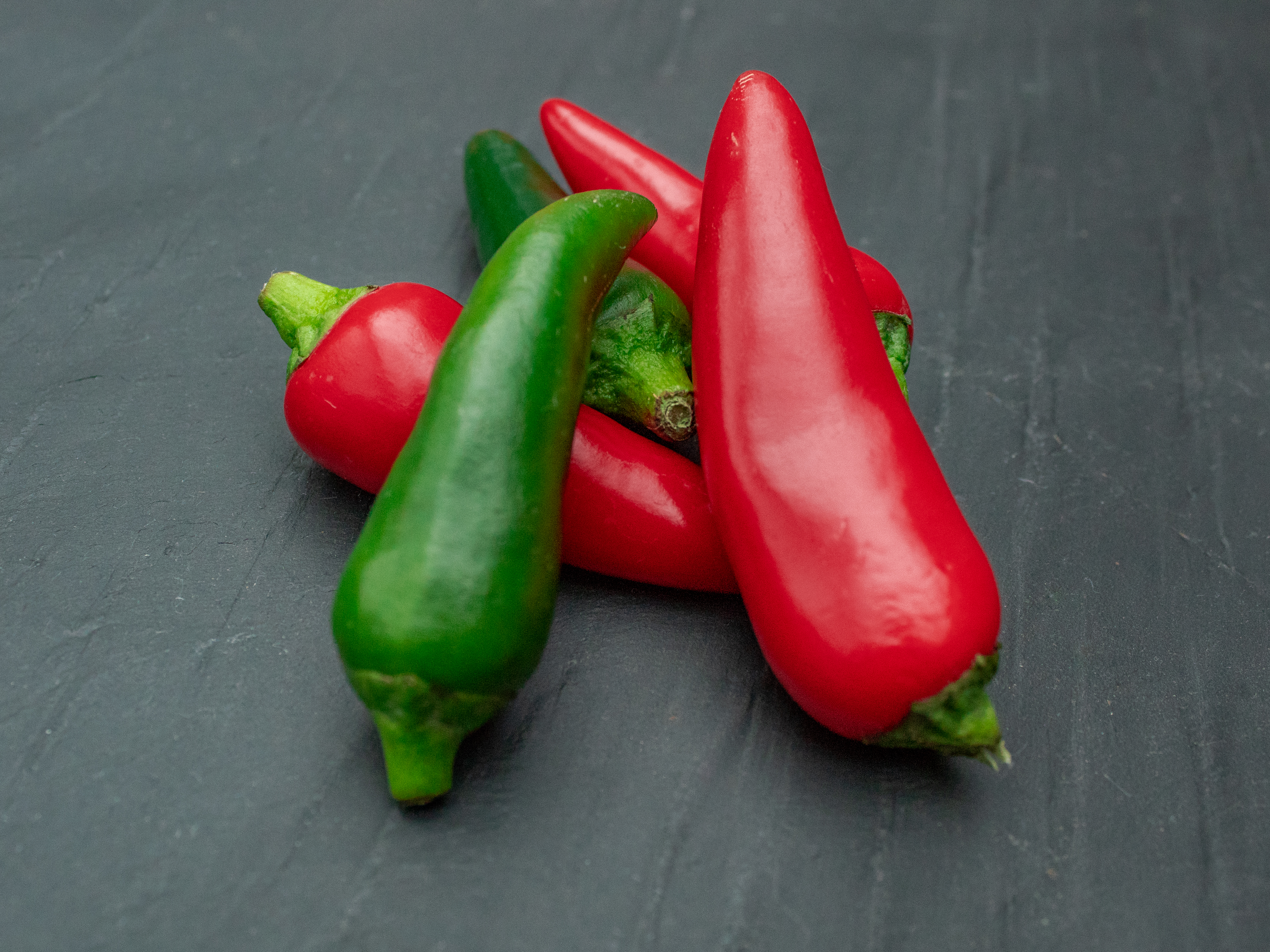 Red and Green Chilies on a Slate