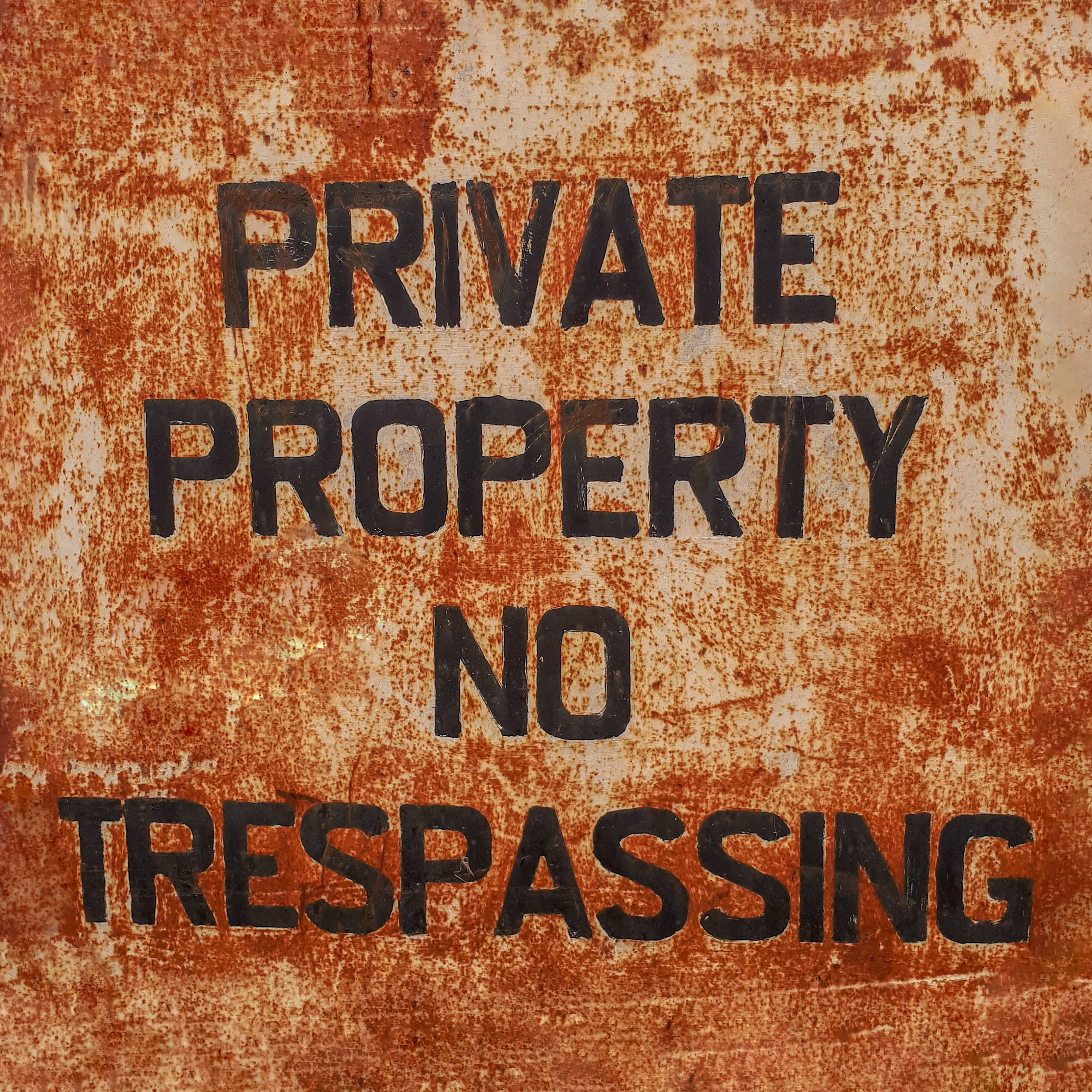 Rusty Old Private Property No Trespassing Sign