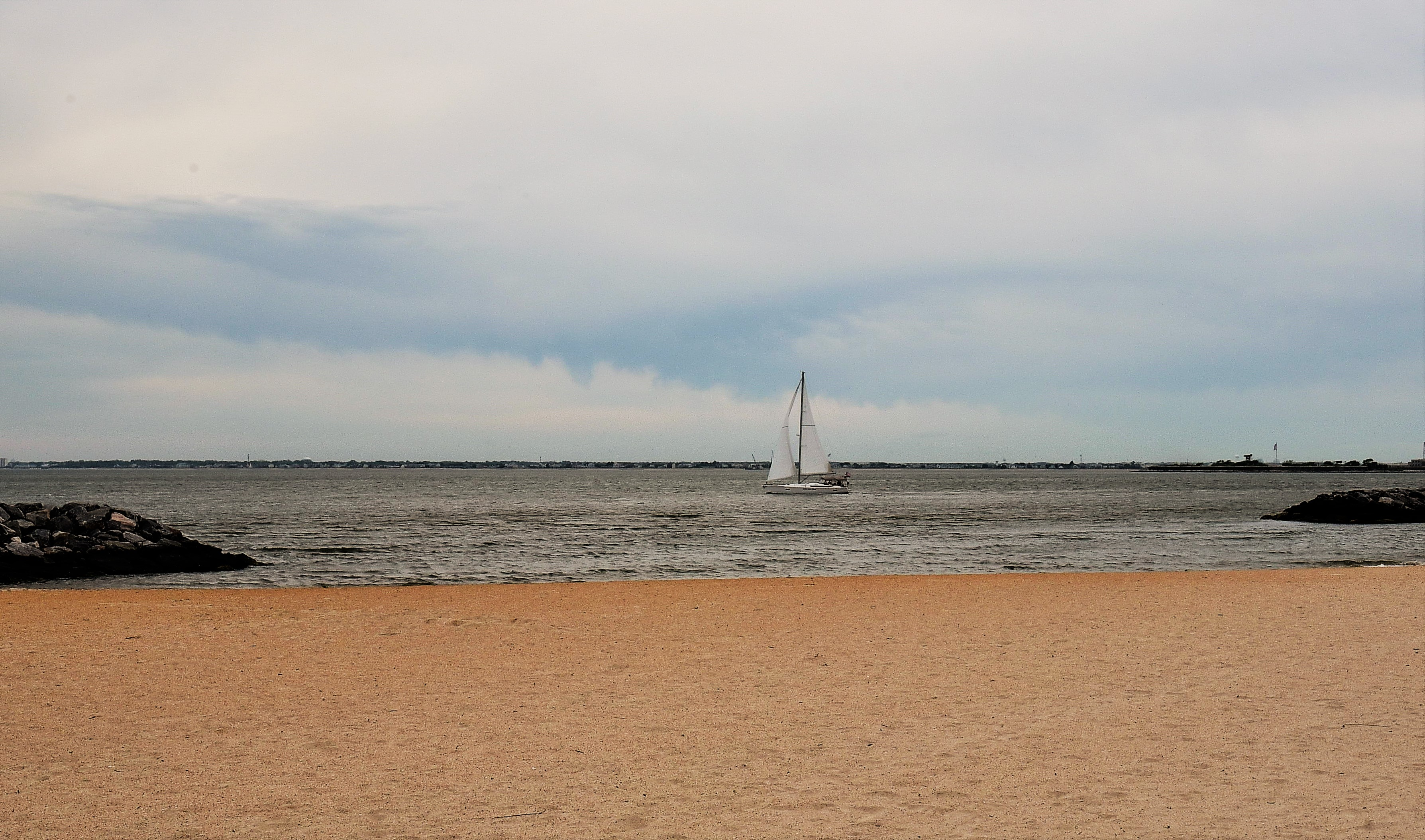 Small Sailboat On The Bay