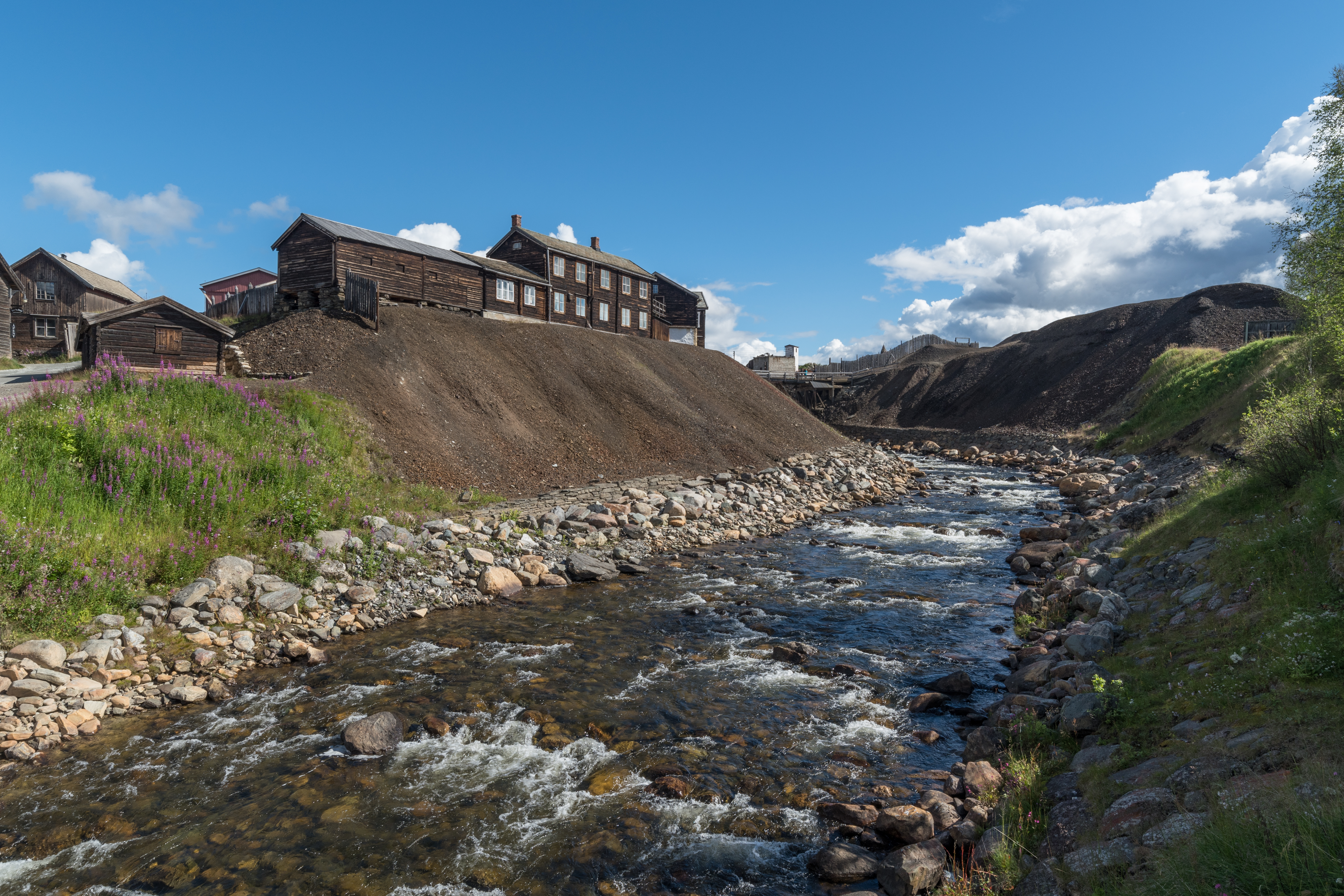 Old mine buildings in Røros with a river