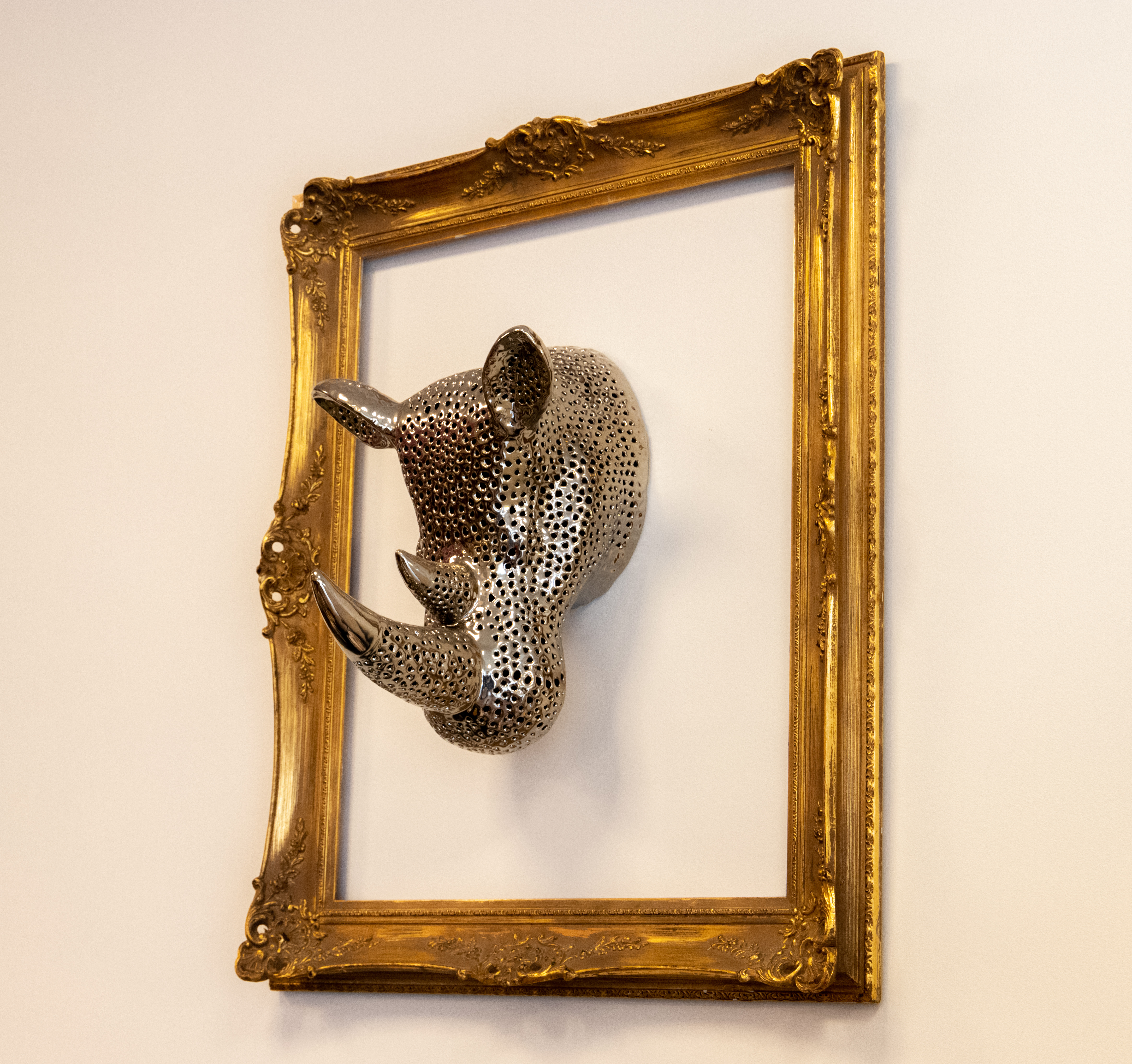 3D rhinos head in frame hanging on wall by Clive Wells