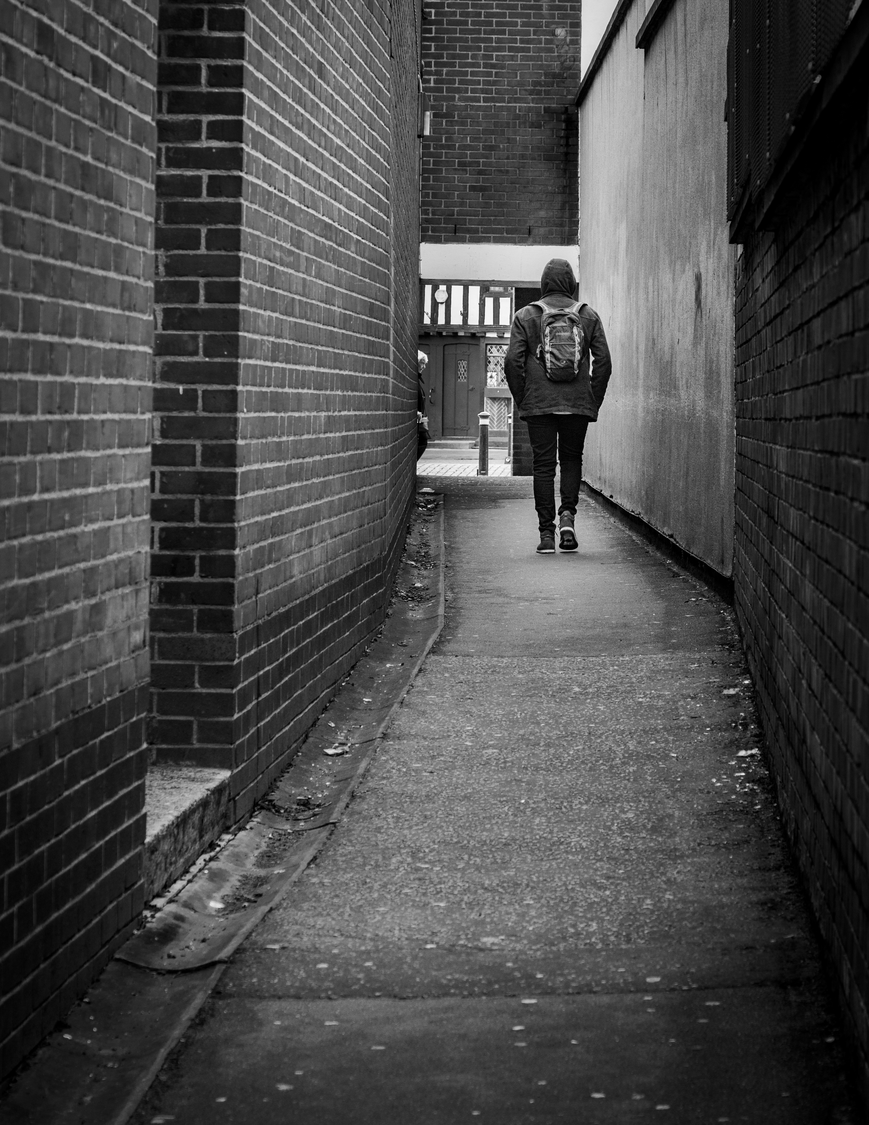 Young man walking through an alley in black & white-2.jpg