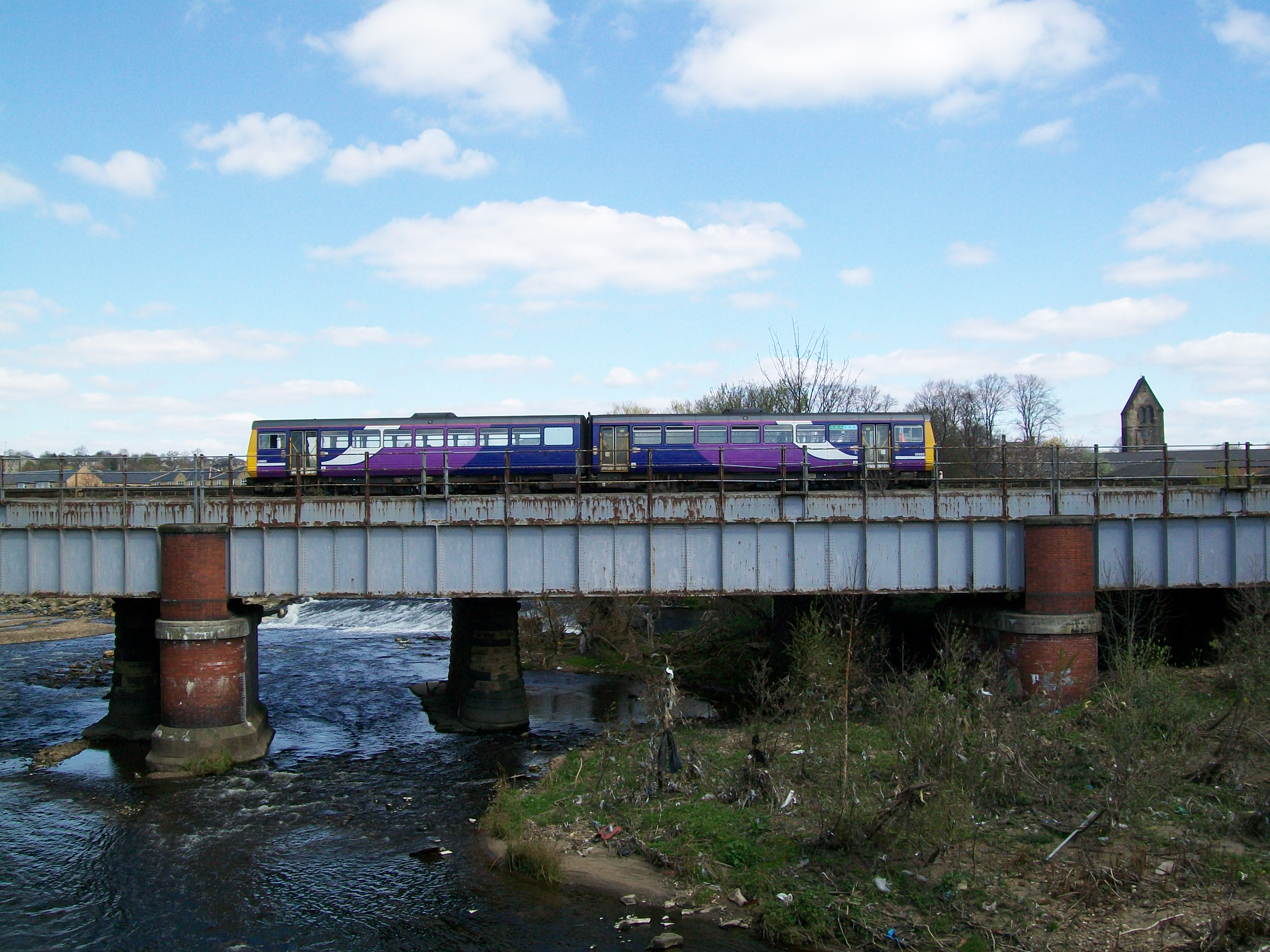 Pacer DMU on the bridge over the River Calder in Mirfield, Thursday 11/04/2019