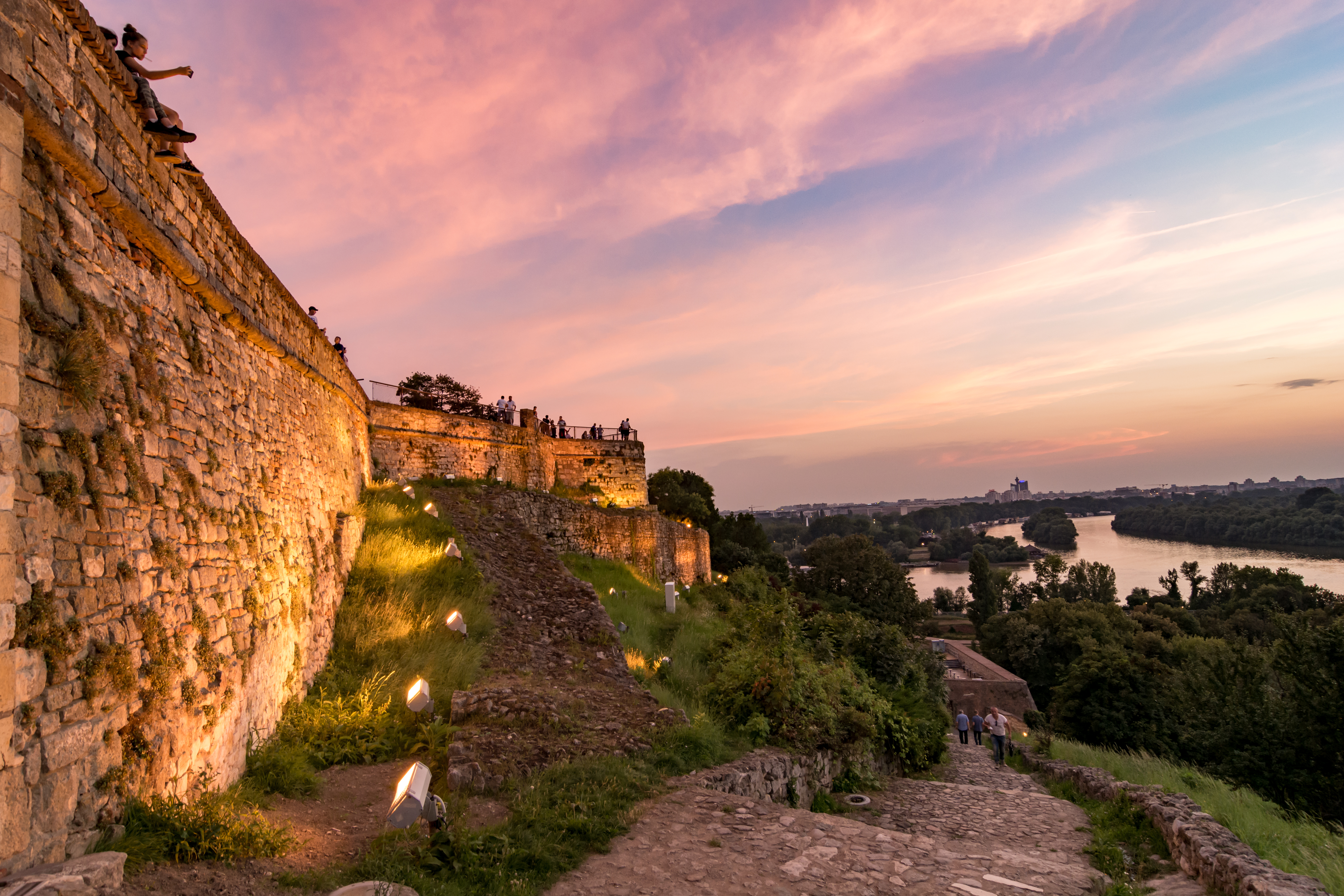 Golden hour over the river with ancient medieval fortress visible