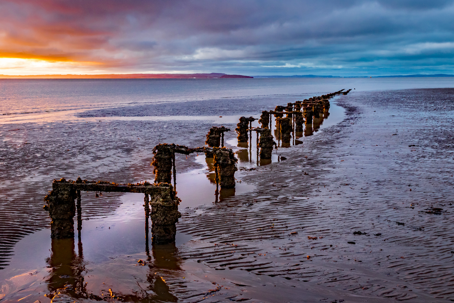 North Wales - old jetty foundations on west beach at Llandudno at sunset
