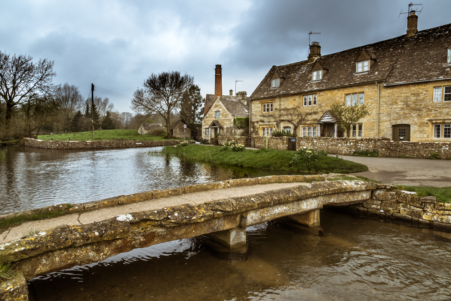 The Cotswolds - footbridge to the old mill at Lower Slaughter